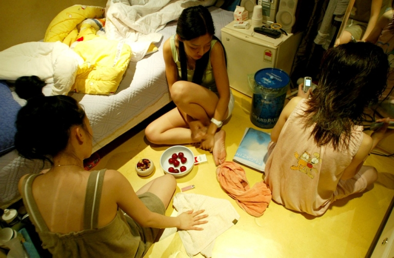 <p>South Korean prostitutes relax in their room before attending a rally to declare 'Sex Worker's day' on June 29, 2005 in Seoul, South Korea. Prostitutes rallied against government law aimed at the sex industry. The government began enforcing new laws in 2004 to target human traffickers, pimps and prostitutes. The sex industry accounts for roughly 1.5 percent of South Korea's gross domestic product (GDP), with its annual sales estimated at $13 billion dollars in 2007.</p>