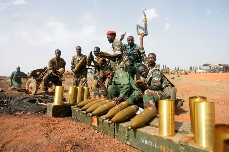 <p>Sudanese soldiers pose next to seized mortar rounds from the Sudanese Peoples Liberation Army (SPLA) of South Sudan in the oil region of Heglig on April 23, 2012.</p>