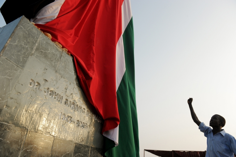 <p>A Southern Sudanese man salutes the statue of late South Sudan rebel leader and first Vice-President John Garang prior to a ceremony celebrating the independence of South Sudan from Sudan in July. South Sudan and Sudan are in conflict over their borders.</p>