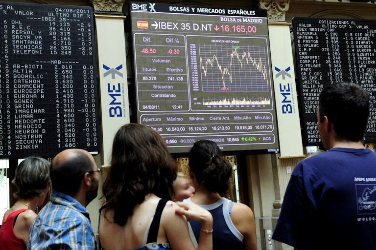 <p>Visitors look at screens in Madrid's Stock Exchange on Aug. 4, 2011 in Madrid, Spain.</p>