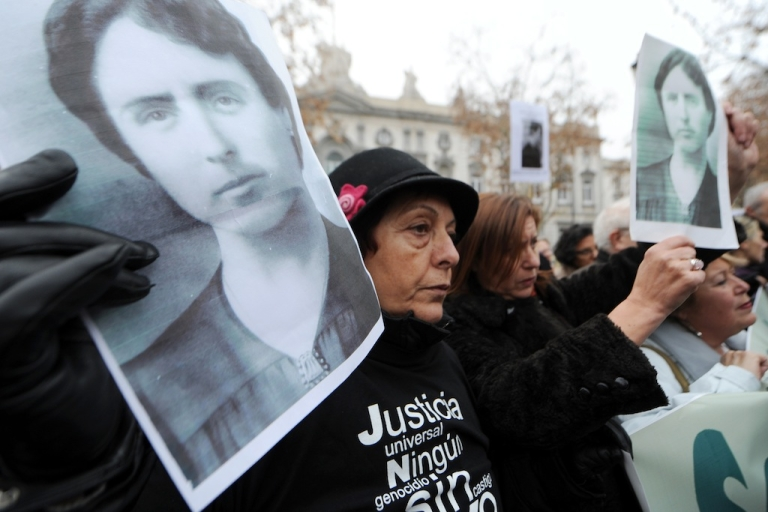 <p>Protesters hold pictures of deceased relatives during Spain's 1936-39 civil war during a demonstration in support of Spanish Judge Baltasar Garzon on January 13, 2012 in Madrid. In May last year Garzon was suspended from his job pending trial for abuse of power after he opened a probe into the disappearance of tens of thousands of people during Spain's 1936-39 civil war and General Francisco Franco's subsequent right-wing dictatorship.</p>