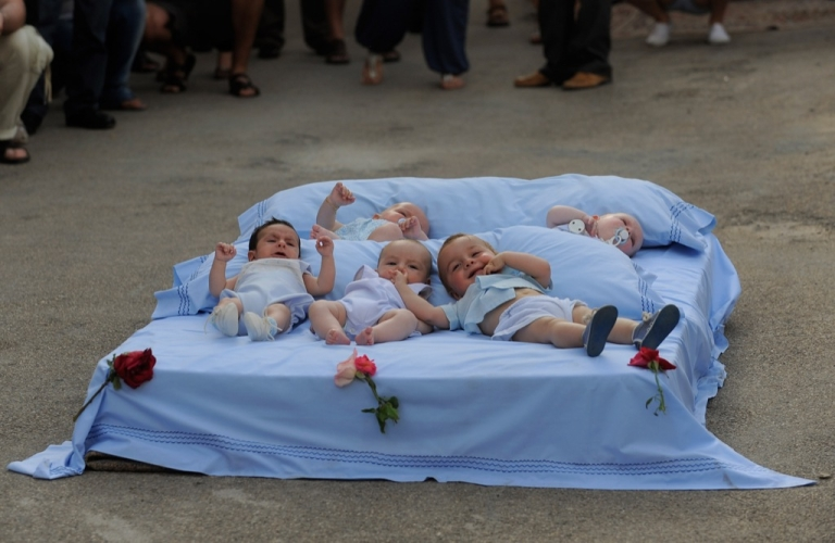 <p>Babies wait for El Colacho to jump over them during the festival of El Colacho on June 26, 2011 in Castrillo de Murcia near Burgos, Spain. The festival, held on the first Sunday after Corpus Cristi, represents the devil taking away original sin from the newly born babies by leaping over them.</p>