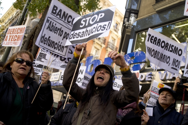 <p>People protest against evictions in Madrid.</p>