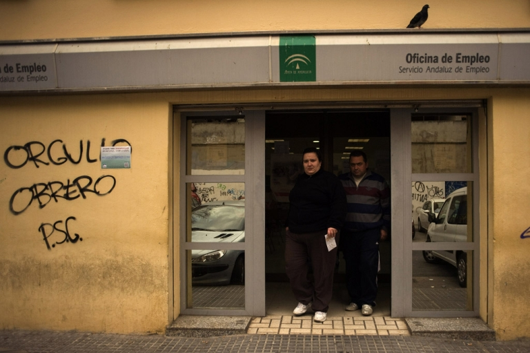 <p>People leave a government employment office in Malaga on January 27, 2012. Spains unemployment rate shot to 22.85 percent in the final quarter of 2011, the highest in the industrialized world, as jobless numbers hit 5.3 million. Graffiti reads