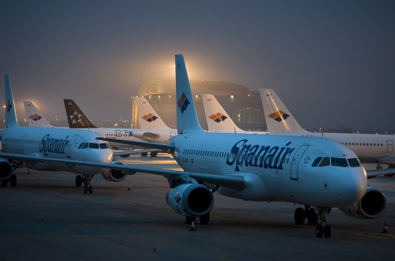 <p>Spanair airplanes stand parked on the tarmac at the El Prat International Airport in Barcelona, Spain. Around 22,770 passengers on 212 flights are estimated to have been left stranded as Spanish airline Spanair announced it had ceased operations.</p>