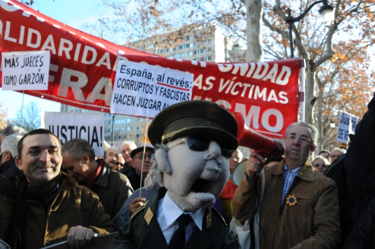 <p>A protestor holds a muppet of Franco on Jan. 24, 2012 during a demonstration in support of Spanish Judge Baltasar Garzon in front of the Spanish Supreme court in Madrid. About 200 supporters of Garzon gathered outside Madrid's Supreme Court as the case against him for ordering an investigation into the disappearance of 114,000 people during Spain's 1936-39 civil war and Franco's subsequent dictatorship started being heard.</p>