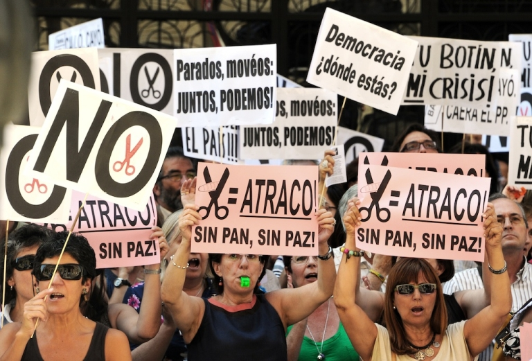 <p>Government employees in Madrid demonstrate against the Spanish government's latest austerity measures on July 17, 2012. Spain has the highest unemployment rate in the euro zone.</p>