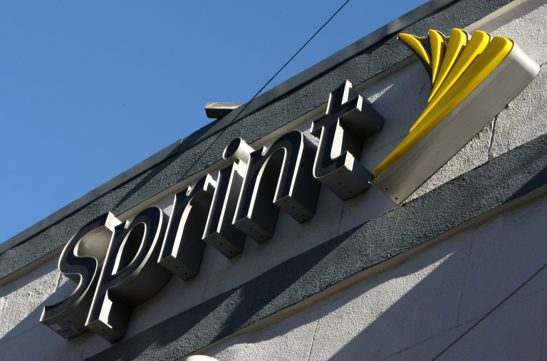 <p>The Sprint logo is displayed on the front of a Sprint retail store in San Francisco, Calif., on Jan. 26, 2009.</p>