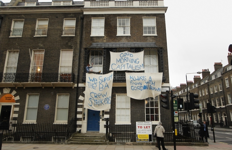 <p>Squatters occupy a large empty house in Bedford Square on March 19, 2010 in London. Under the new law, these squatters could be arrested and, if convicted, sent to jail for up to six months.</p>