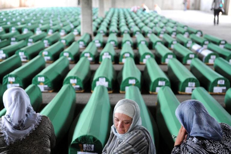 <p>Bosnian muslim women cry among 520 caskets awaiting a mass burial ceremony at the Srebrenica Memorial Cemetery, on July 10, 2012. Some 8,000 Muslim men and boys were killed in just a few days after the eastern town under UN protection was captured by Bosnian Serb forces in July 1995; on Sept. 6, 2013, a court ruled that Dutch peacekeepers could have saved at least three of them.</p>