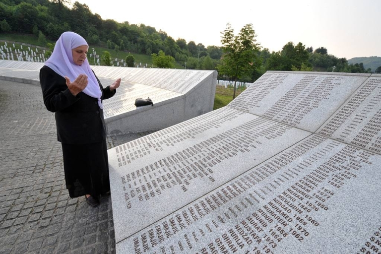 <p>A Bosnian Muslim survivor of the Srebrenica massacre of 1995 prays in front of the memorial wall of victims of the atrocity. A court decision determined that the Dutch UN troops compensate the families of three slain Bosnian Muslim men.  The Dutchbat was supposed to protect these men but instead handed them over to the Bosnian Serbs.</p>