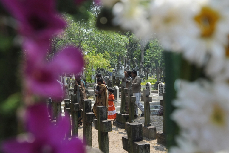 <p>Relatives leave after placing flowers on the grave of a loved one on All Souls Day at the main cemetery in the Sri Lankan capital of Colombo on Nov. 2, 2008. AFP PHOTO/Ishara S. KODIKARA (Photo credit should read Ishara S. KODIKARA/AFP/Getty Images)</p>