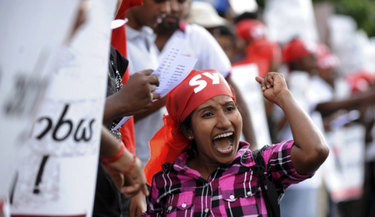<p>A family member of a missing Sri Lankan  attends a protest in the capital Colombo on July 28, 2011. Hundreds of protesting ethnic minority Tamils demanded information about family members who had disappeared during the decades-long ethnic conflict which ended in May 2009.</p>