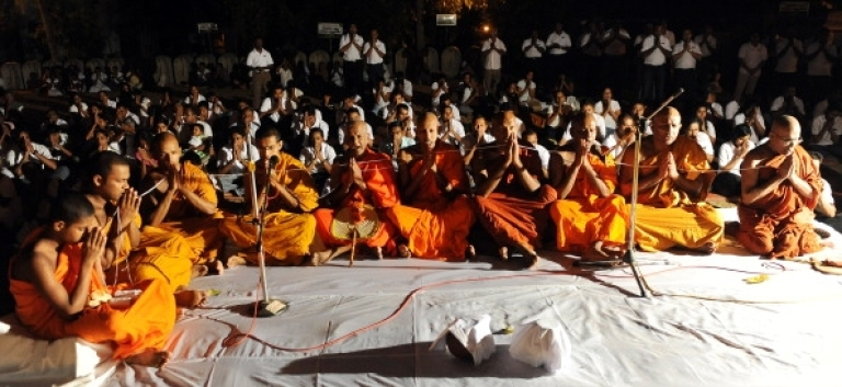 <p>Sri Lankan Buddhist monks offer special prayers to bless the national cricket team at the Kelaniya Temple in Kelaniya on April 1, 2011.</p>