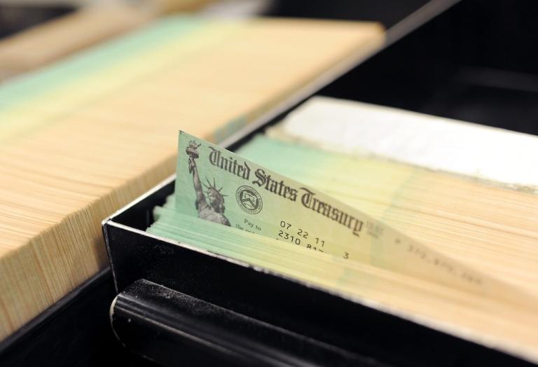 <p>Blank U.S. Treasury checks are run through a printer at the U.S. Treasury printing facility July 18, 2011 in Philadelphia, Pennsylvania.</p>
