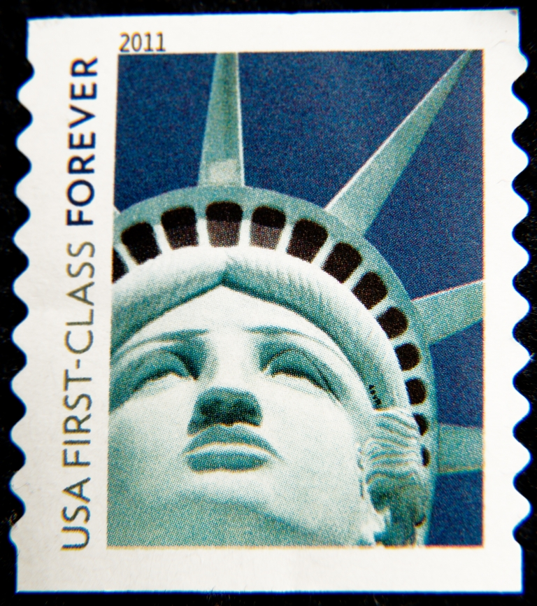 <p>A close-up of a Statue of Liberty postage stamp.</p>