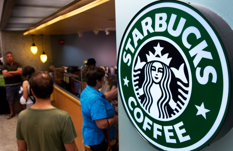 <p>Customers queue for coffee at Starbucks at Dulles International Airport in Dulles, Va., on Aug. 30, 2011.</p>