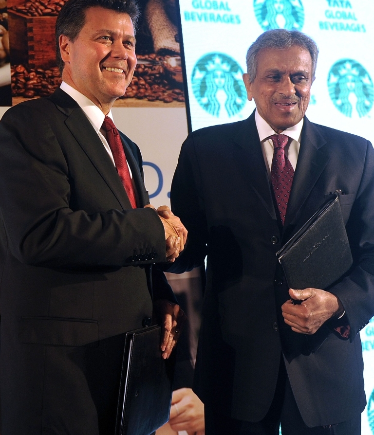 <p>John Culver, president of Starbucks' China and Asia Pacific division (L), shakes hands with Tata Global Beverages Vice Chairman R.K. Krishnakumar at a press conference in Mumbai on January 30, 2012. Starbucks, the world's biggest coffee shop chain, aims to open 50 outlets in India by the end of the year through a joint venture with Tata.</p>