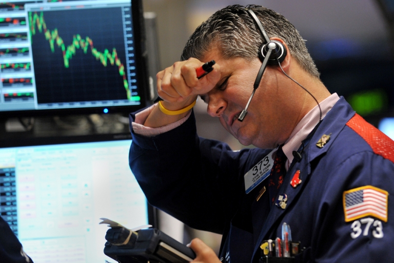 <p>Trader John W. Panin of JNK Securites Corp. works on the floor of the New York Stock Exchange on August 4, 2011.</p>