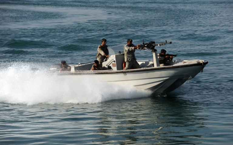 <p>Iranian Army soldiers stand guard on a military speed boat during the 'Velayat-90' navy exercises in the Strait of Hormuz in southern Iran on December 28, 2011.</p>