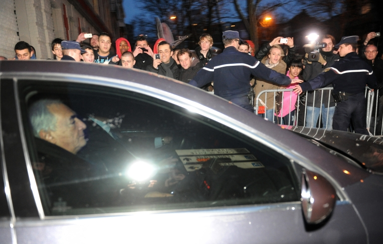 <p>Disgraced former IMF chief Dominique Strauss-Kahn leaves a French police station yesterday in Lille, northern France after two days of questioning about a series of sex parties</p>