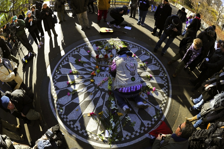 <p>Fans gather at Strawberry Fields in Central Park, New York City, dedicated to the late Beatle. Lennon often visited this section of the park and was murdered across the street in front of his home at the Dakota building.</p>