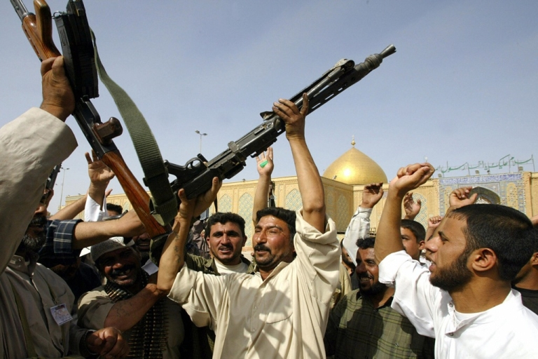 <p>A militiaman (C) dances with a heavy machinegun he gained during fierce battles against US forces in the holy city of Najaf, south of Baghdad. A new study explains why some Muslim countries harbor anti-American sentiment.</p>