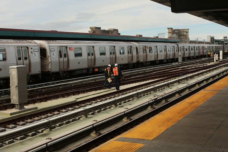 <p>Metropolitan Transportation Authority workers walk the tracks two days after a man was pushed to his death in front of a train on Dec. 5, 2012 in New York City.</p>