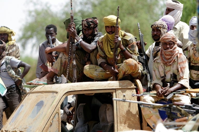 <p>Fighters of Sudan's Justice and Equality (JEM) Movement wait to greet Sudanese presidential adviser Nafie Ali Nafie during his visit to al-Fasher, Northern Darfur, on July 25, 2011.</p>