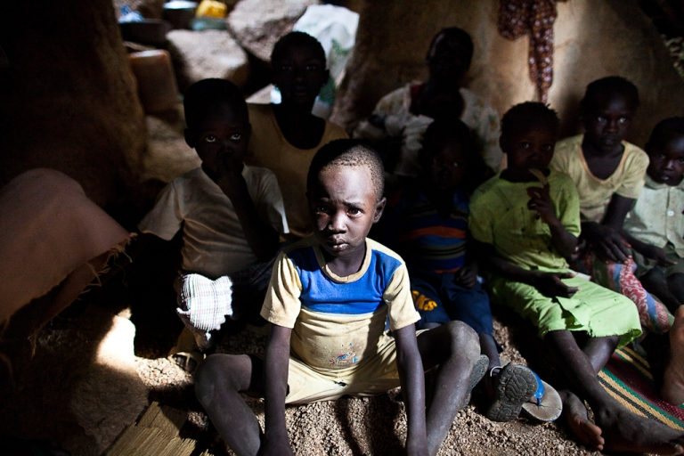 <p>Sudanese President Omar Al-Bashir's government is resisting U.S. and UN aid.<br /> Sudanese children take shelter in caves in the Nuba Mountains of South Kordofan province as government bombers pass overhead on July 13, 2011. Thousands of people from the Nuba region have fled to caves after repeated attacks by Sudan government forces on civilian areas.</p>