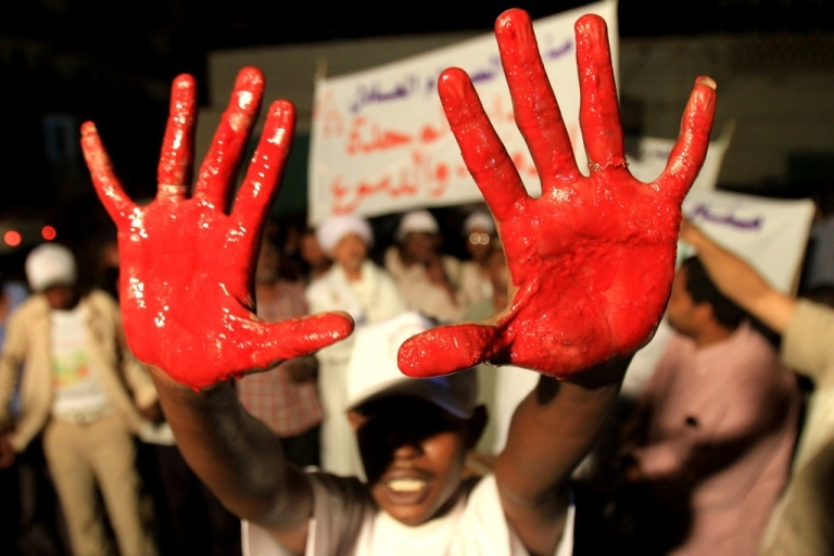 <p>A Sudanese man shows the palms of his hands after he dipped them in the blood of a sacrificial cow as he and others celebrate the results of the January referendum on the secession of southern Sudan from the north in the capital Khartoum, on February 7, 2011. Southern Sudan is on track to become the world's newest state after final results of its historic independence referendum showed that 98.83 percent of its people had voted for secession.</p>