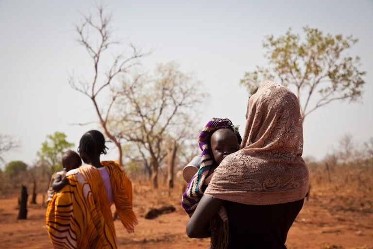 <p>In Sudan a teenaged mother has been sentenced to death by stoning for alleged adultery. Here, a different Sudanese woman with her young baby.</p>