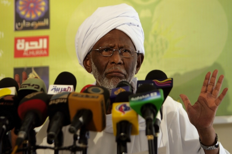 <p>Sudan's Islamist opposition leader Hassan al-Turabi addresses the media in Khartoum following his release on January 5, 2012 after more than three months in jail. The veteran politician, who was arrested in January shortly after warning of a Tunisia-style uprising, was defiant following his release, saying he was never investigated or charged, and again calling for a revolution in Sudan 'against corruption.'</p>