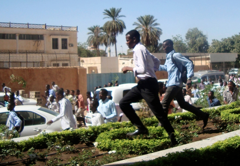 <p>Sudanese students run during a demonstration in the capital Khartoum on December 9, 2012, as they rallied in support of four dead students originally from the conflict-plagued Darfur region, witnesses said. The death of the four has prompted a re-emergence of Arab Spring-inspired calls for the downfall of the government.</p>