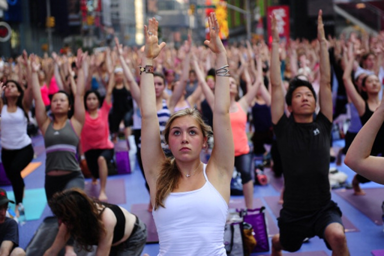 <p>Participants take part in a mass yoga class to mark the summer solstice in New York City's Times Square on June 20, 2012.</p>
