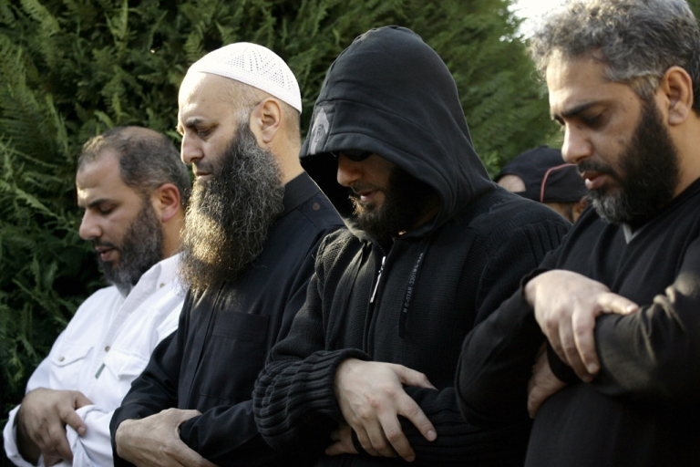 <p>Sunni Salafi Sheikh Ahmed al-Assir (second from the left) and Singer Fadel Shaker (right) pray during a funeral in the southern Lebanese port city of Sidon, on Nov. 12, 2012.</p>