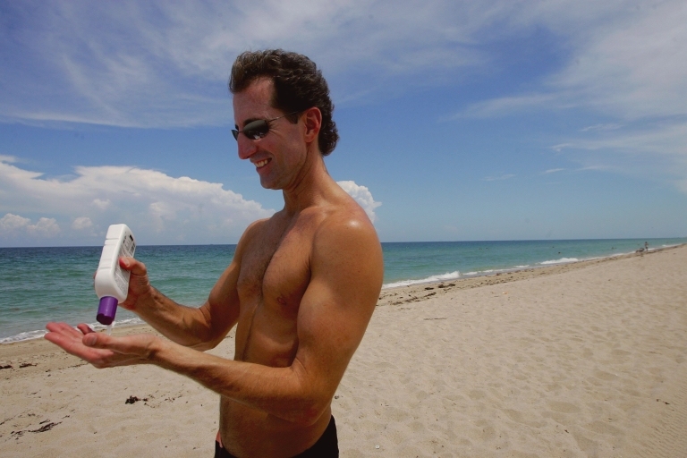 <p>Rick Johnson applies sunscreen during a visit to the beach in Fort Lauderdale, Fla., on June 20, 2006.</p>