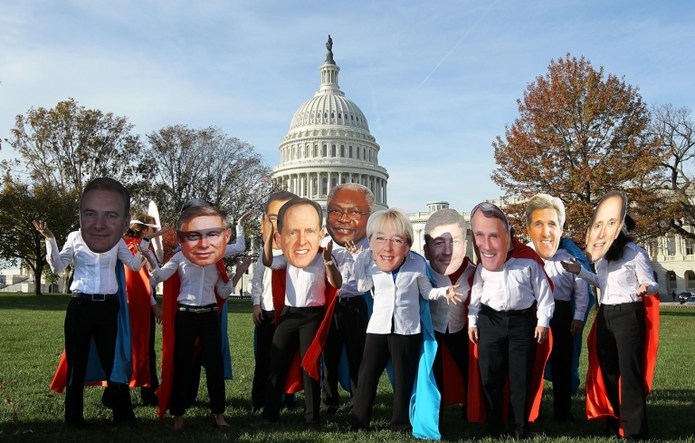 <p>Activists of Oxfam America dress as members of the congressional Joint Select Committee on Deficit Reduction, also known as the Super Committee, as they pose for the media in front of the US Capitol October 26, 2011 in Washington, DC.</p>