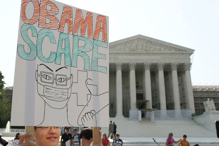 <p>A man protests against the Obama administrations health care plan during a protest in front of the US Supreme Court, on June 28, 2012 in Washington, DC. Today the high court is expected to rule on the constitutionality of the sweeping health care law championed by President Barack Obama.</p>
