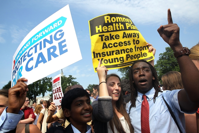 <p>Obamacare supporters, (L-R) Kailash Sundaran of Cupertino, California, Devyn Greenberg of New York City, and Devontae Freeland of Metuchen, New Jersey celebrate as they respond to the Supreme Court ruling on the Affordable Health Act June 28, 2012 in front of the U.S. Supreme Court in Washington, DC.</p>