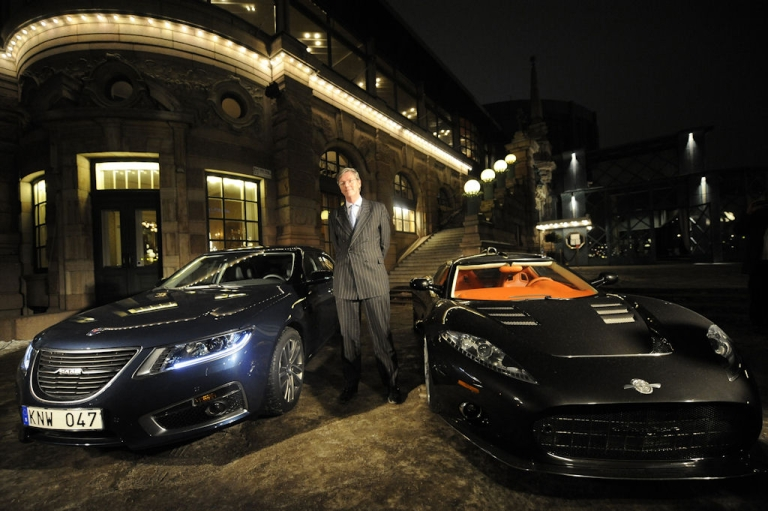 <p>Victor Muller, CEO of Spyker Cars, poses between a Saab car (left) and a Spyker (right) in Stockholm on Jan. 26 , 2010 after General Motors announced an agreement to sell Saab to Dutch luxury sports car maker Spyker, in an 11th-hour deal saving the storied Swedish brand.</p>