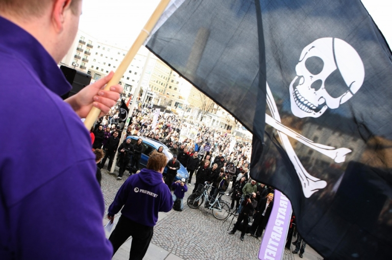 <p>Supporters of the web site 'The Pirate Bay', one of the world's top illegal filesharing websites, demonstrate in Stockholm, on April 18, 2009, after a Swedish court sentenced four members to a year in prison for promoting copyright infringement.</p>