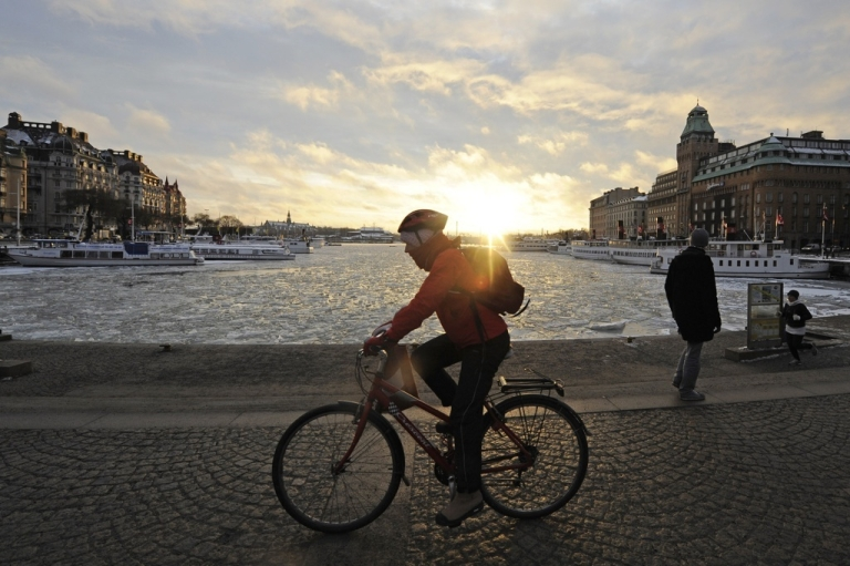 <p>A man rides to work in front of Stockholm's frozen harbor, in January 2010. Progressive policies and a tight-knit, tech culture has made Sweden a Silicon Valley rival.</p>