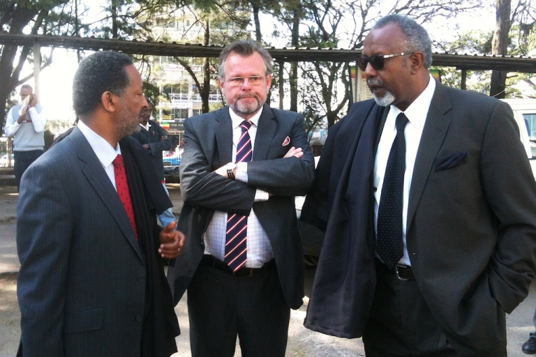 <p>Sweden's Ambassador to Ethiopia Jens Odlander (C) stands next to Seleshi Ketsela (L) and Abebe Balcha (R), both lawyers for two Swedish journalists found guilty of supporting terrorism in Ethiopia, outside an Addis Ababa courtroom on Dec. 27, 2011.</p>