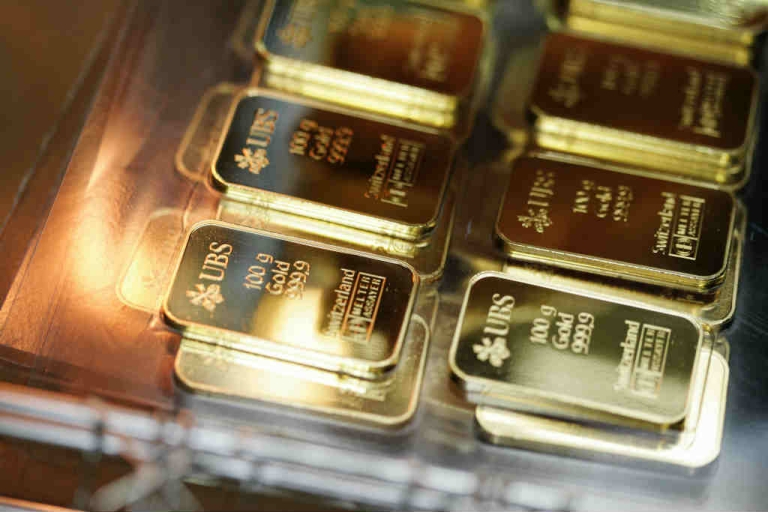 <p>100g golden bars engraved with the logo and name of the swiss bank UBS are pictured at a plant of gold refiner and bar manufacturer Argor-Heraeus SA in Mendrisio, southern Switzerland.</p>