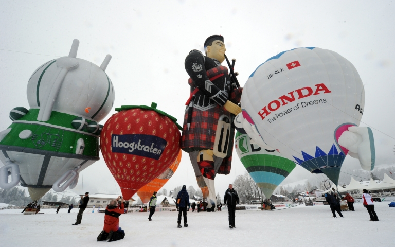 <p>Balloonists prepare their hot air balloons for takeoff in the Swiss Alps resort of Chateau d'Oex on January 28, 2012 during the 34th International Balloon Festival. Voters in Switzerland rejected a measure to increase their minimum paid time off to six weeks in March.</p>