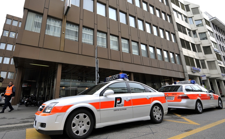 <p>Police cars are seen next to the building housing the Swiss nuclear power industry association, on March 31, 2011 in Olten.</p>