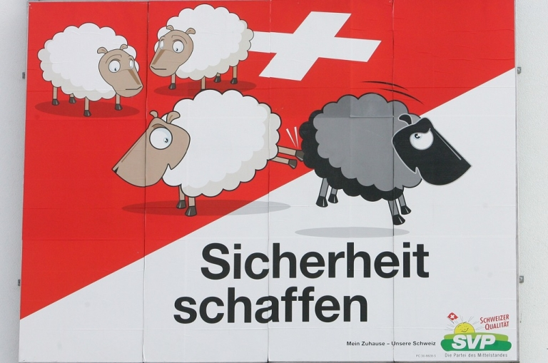 <p>An election poster of the Swiss People's Party (SVP) for the Switzerland's 2007 federal elections hangs in Basel.  The party has come under heavy international criticism for leading a campaign that emphasizes sharp measures against immigrants.</p>