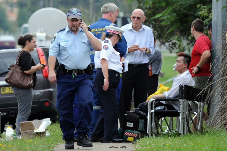 <p>A man is given oxygen by ambulance staff after a fire engulfed a nursing home for the elderly, killing at least three and seriously injuring eight, near Sydney on November 18, 2011.</p>
