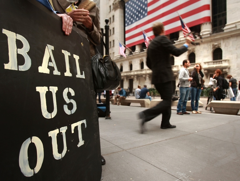 <p>People protest outside of the New York Stock Exchange October 13, 2008 in New York City.</p>